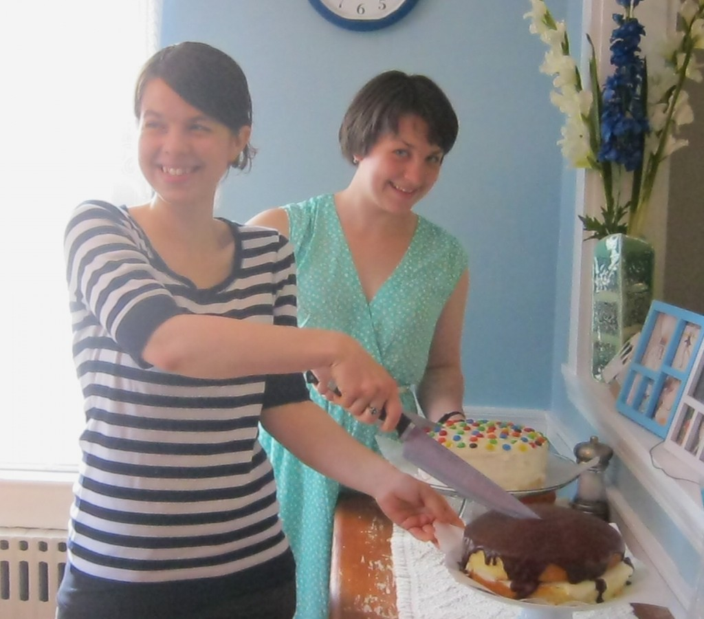 photo of girls cutting cakes