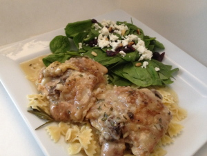 photo of plate of chicken, pasta, and a side of spinach salad