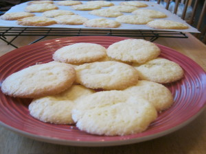 photo of cookies on plate with cooling cookies in background