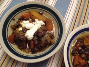 Picture of bowl with Tex-Mex Chicken with Black Beans topped with goat cheese